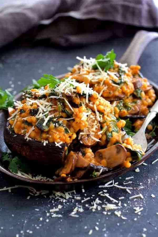 Barley Risotto Stuffed Portobello Mushrooms - Fork taking some of the stuffing off the mushroom