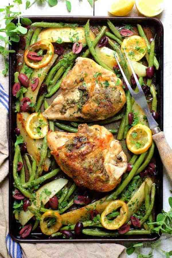 Sheet Pan Roast Chicken with Potatoes, Green Beans, Olives and Lemon - Overhead hero shot on white background