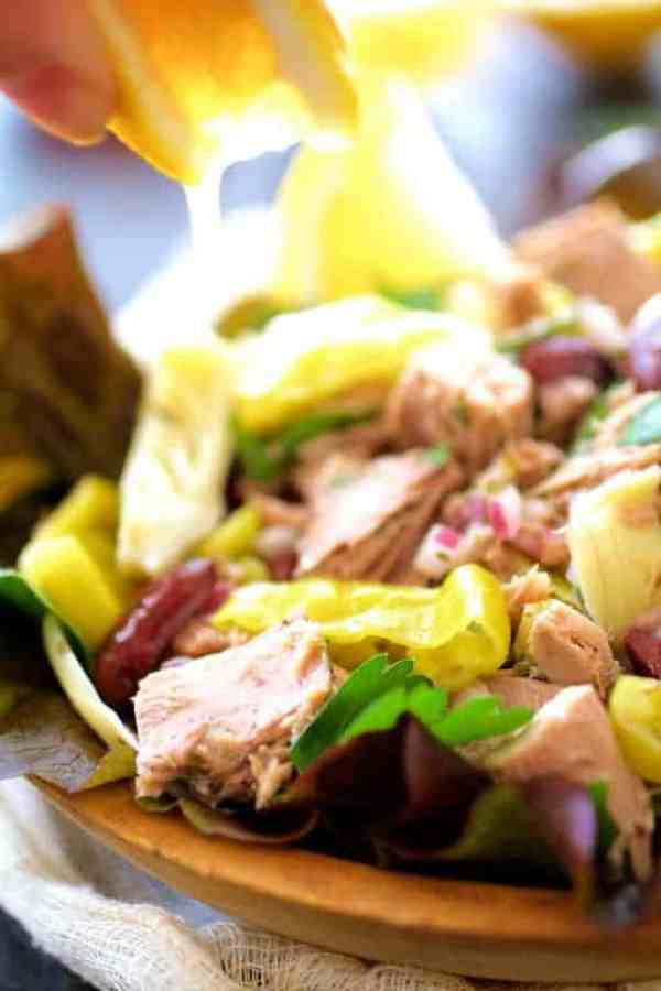 Quick Pantry Mediterranean Tuna Salad - Lemon juice being drizzled over salad