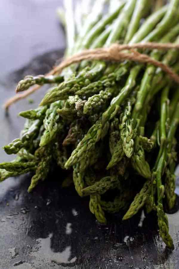 Bunch of freshly washed asparagus tied with twine