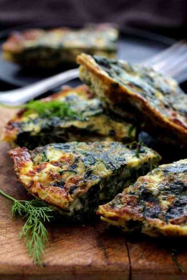 Spinach Leek and Feta Cheese Frittata - Close-up shot of frittata wedges on wood cutting board