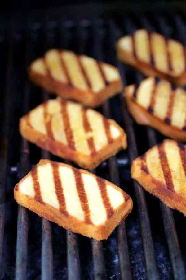 Grilled Pound Cake with Balsamic Macerated Strawberries and Mascarpone Cream - Grilled pound cake slices on grill