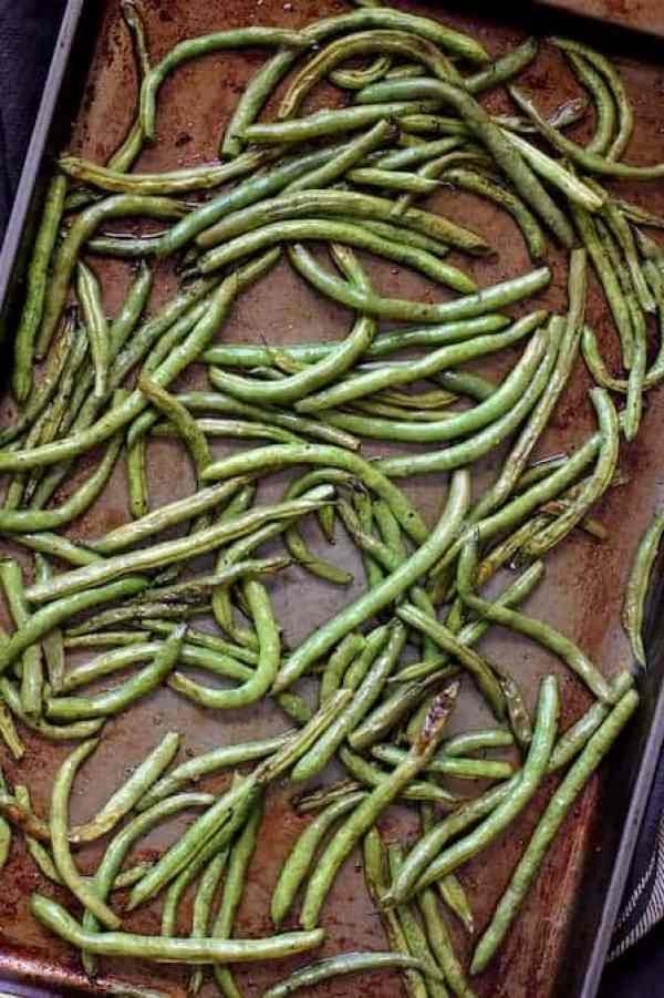 Roasted Green Beans with Tomato Caper Relish - Roasted green beans on baking sheet