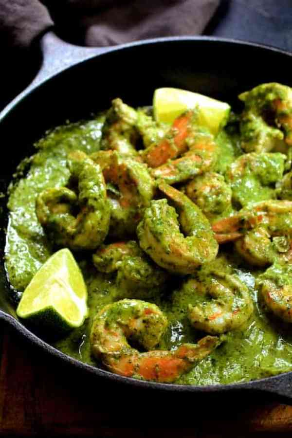 Shrimp in Avocado Butter - Another shot of the dish in cast iron skillet garnished with lime wedges