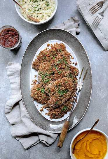 Pecan Crusted Turkey Cutlets with Red Onion Marmalade - Overhead hero shot of dish on gray-rimmed platter