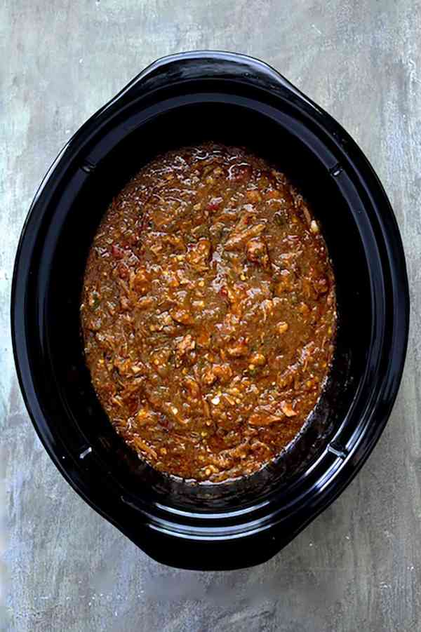 Slow Cooker Colorado Green Chili - Overhead shot of chili in slow cooker on gray background