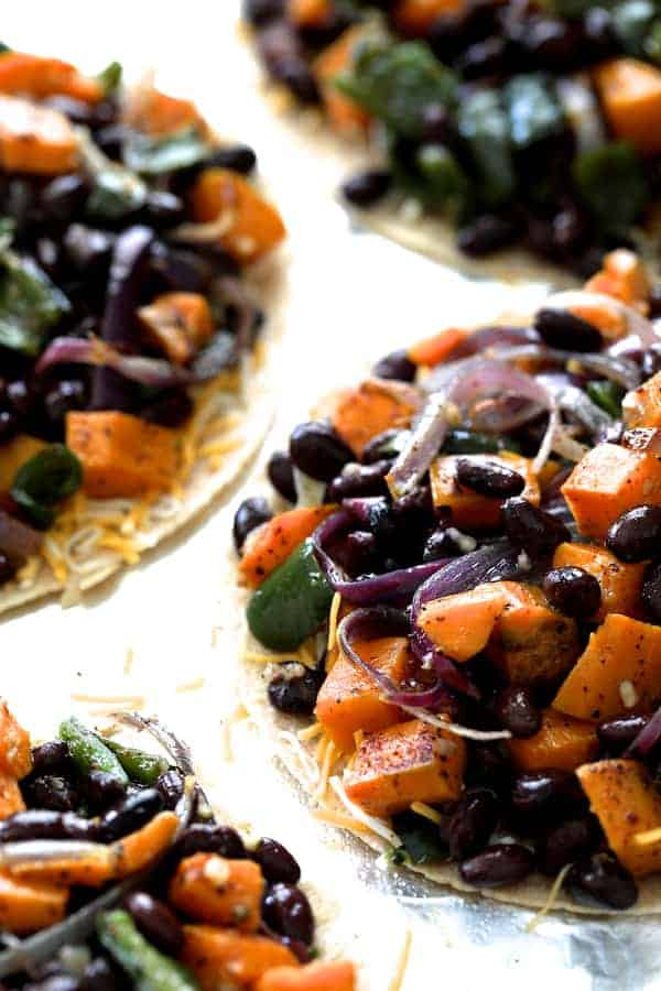 Sheet Pan Quesadillas with Sweet Potatoes, Poblanos and Black Beans with Chipotle Sour Cream - Filling on tortillas without top tortilla