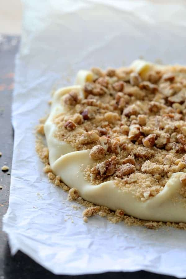 Sweet Potato Galette with Pecan Streusel Topping - Shot of galette with edges folded in topped with pecan streusel topping before baking