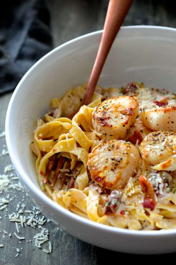 Seared Sea Scallops with Spicy Bacon and Sun Dried Tomato Alfredo Sauce [Bertolli) close-up of pasta and scallops