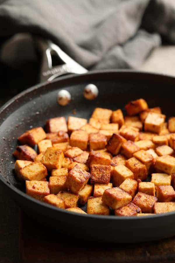 Vegan Korean Tofu Lettuce Wraps with Tahini Gochujang Sauce and Spicy Slaw - Photo of browned tofu in frying pan