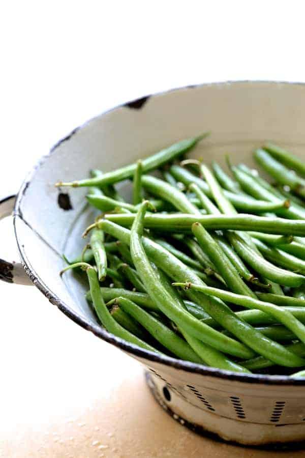 French Lentil Salad - Fresh green beans in white colander