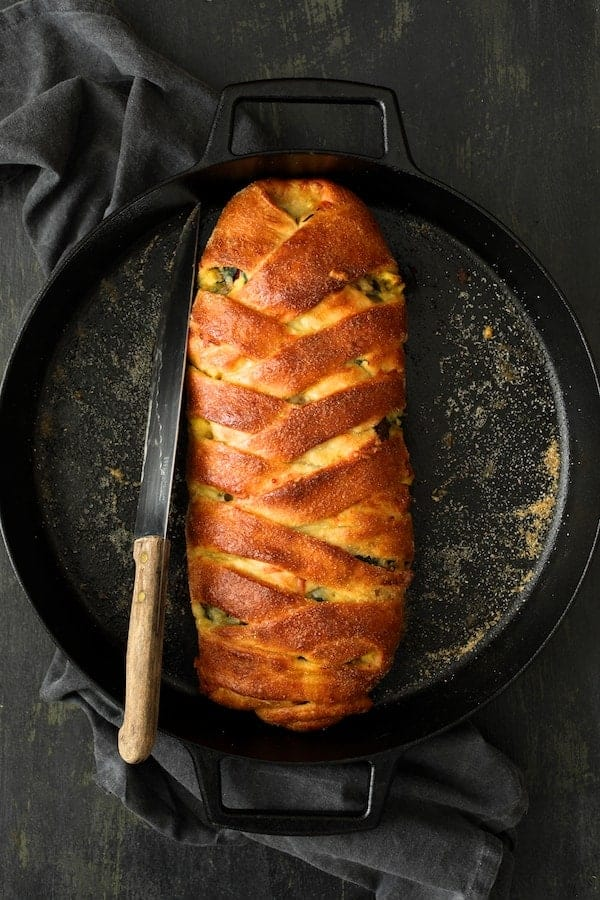 Savory Breakfast Strudel with Eggs Sausage and Swiss Chard - Hero shot in cast iron pan after baking