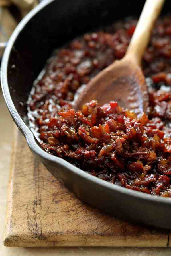 Grilled Burgers with Bacon Tomato Jam and Smoked Gouda - Close-up shot of bacon jam in cast iron skillet
