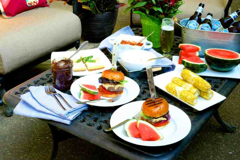 Grilled Burgers with Bacon Tomato Jam and Smoked Gouda - Shot of full The Fresh Market meal set-up outdoor on the patio