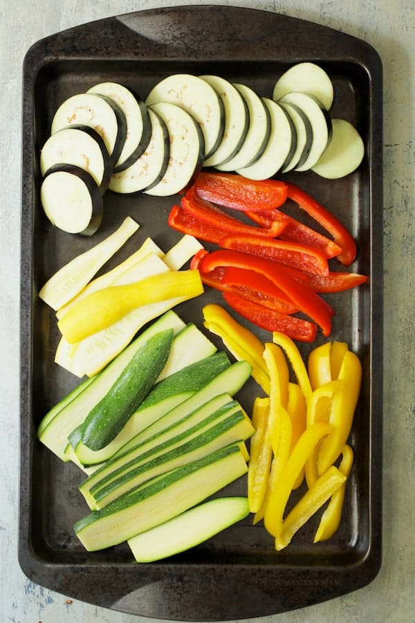 Italian Summer Vegetable Casserole - Raw vegetables on baking sheet sliced and ready for the grill