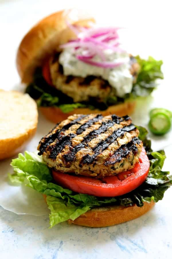 Chicken Zucchini Feta Burgers with Jalapeño Tzatzik - Photo of bare chicken burger ready for dressing on tomato, lettuce and bun