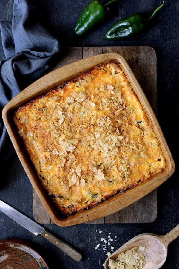 Southwestern Squash Corn and Poblano Casserole - Hero overhead shot of casserole on wood cutting board