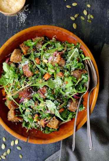 Autumn Panzanella Salad - Overhead hero shot of salad in wood bowl on dark blue background