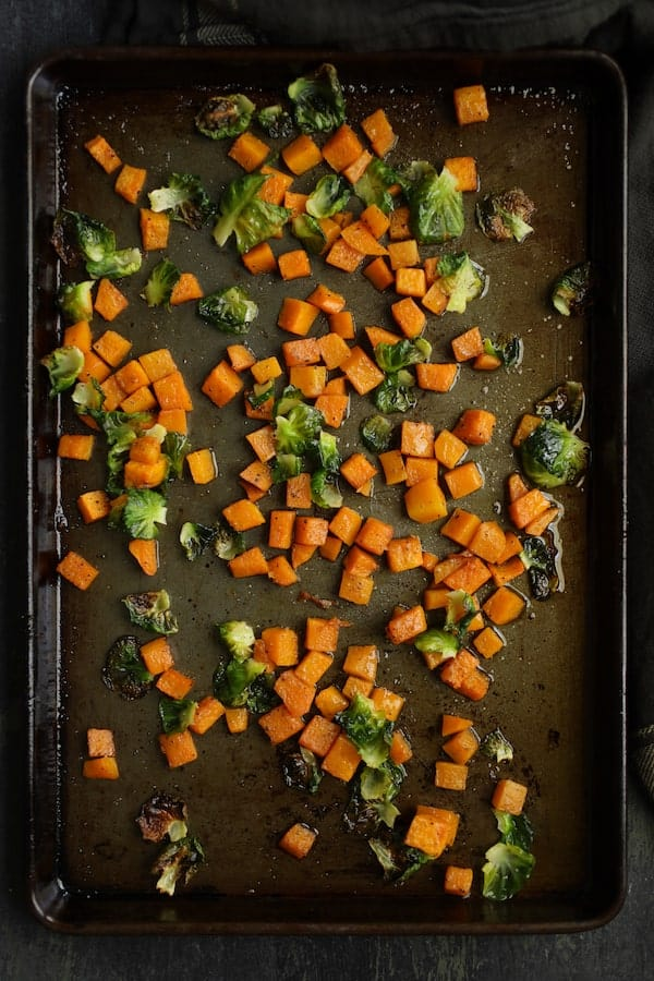 Autumn Panzanella Salad - Butternut Squash and Brussels sprouts on baking sheet after roasting