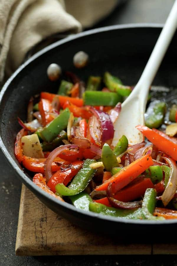 Italian Sausage and Bell Pepper Polenta Bake - Cooked bell peppers in skillet
