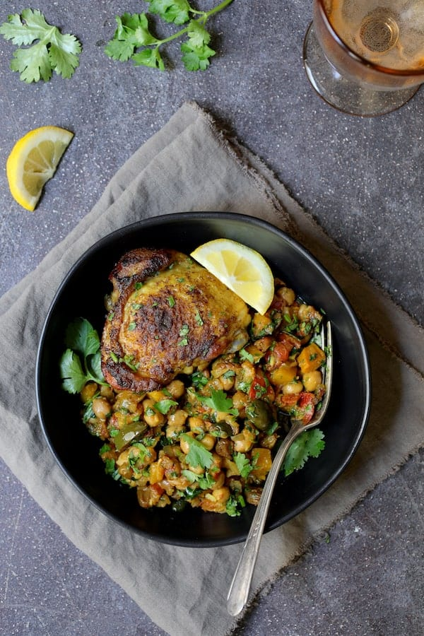 Moroccan Chicken Tagine with Butternut Squash Chickpeas and Olives - Overhead shot of individual portion in black bowl