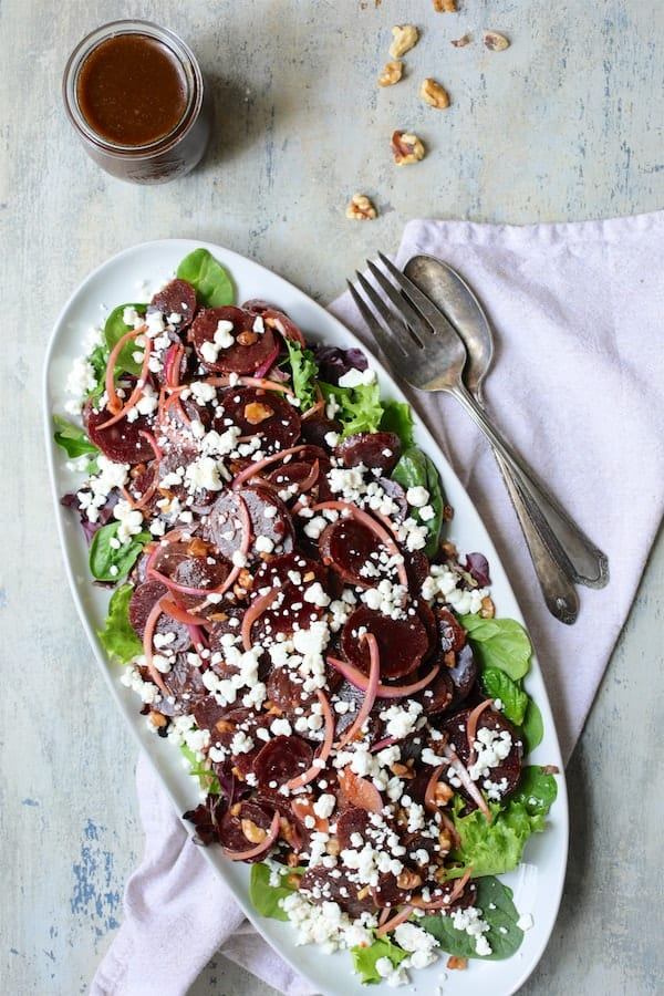 Roasted Beet Salad with Walnuts Goat Cheese and Honey Balsamic Dressing - Another shot of salad closer up with platter on an angle