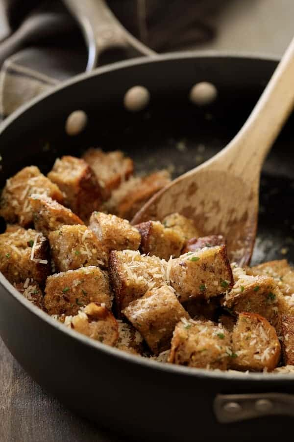 Whole Grain Thyme Rosemary and Parmesan Croutons - Croutons in saute pan with herbs and butter