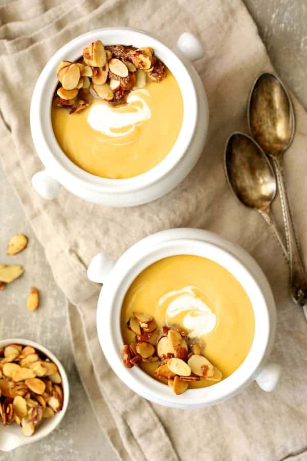Pumpkin Soup with Marsala and Mascarpone - Overhead shot of soup in white bowls closer up