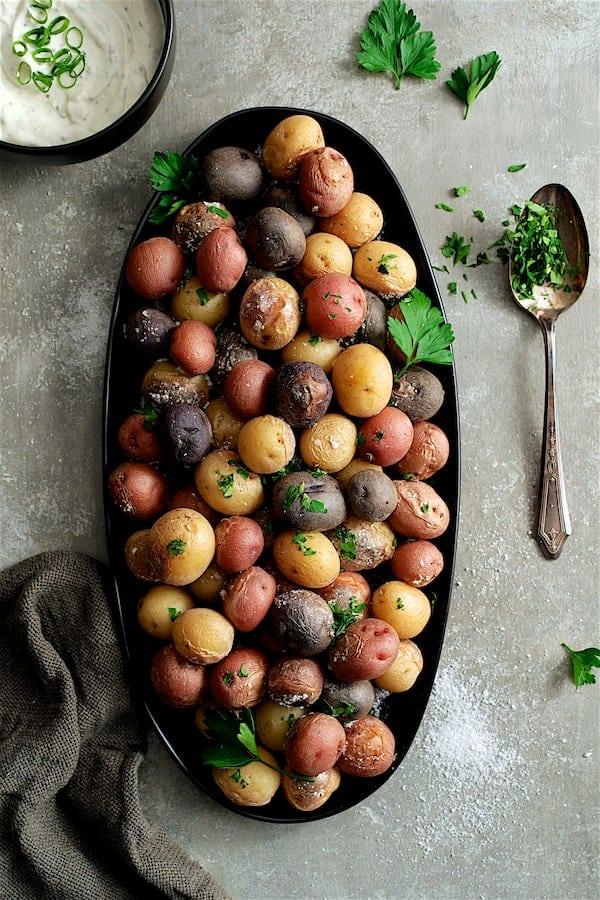 Skillet Salt Roasted Baby Potatoes with Sour Cream Horseradish Sauce - Overhead shot of potatoes on black platter
