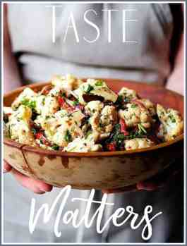 Taste Matters Cover - Photo of woman holding a wooden bowl of cauliflower salad