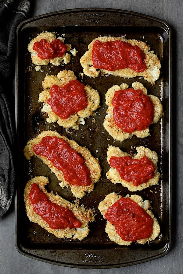 Cauliflower Parmigiana - Overhead shot of cauliflower covered with some marinara sauce