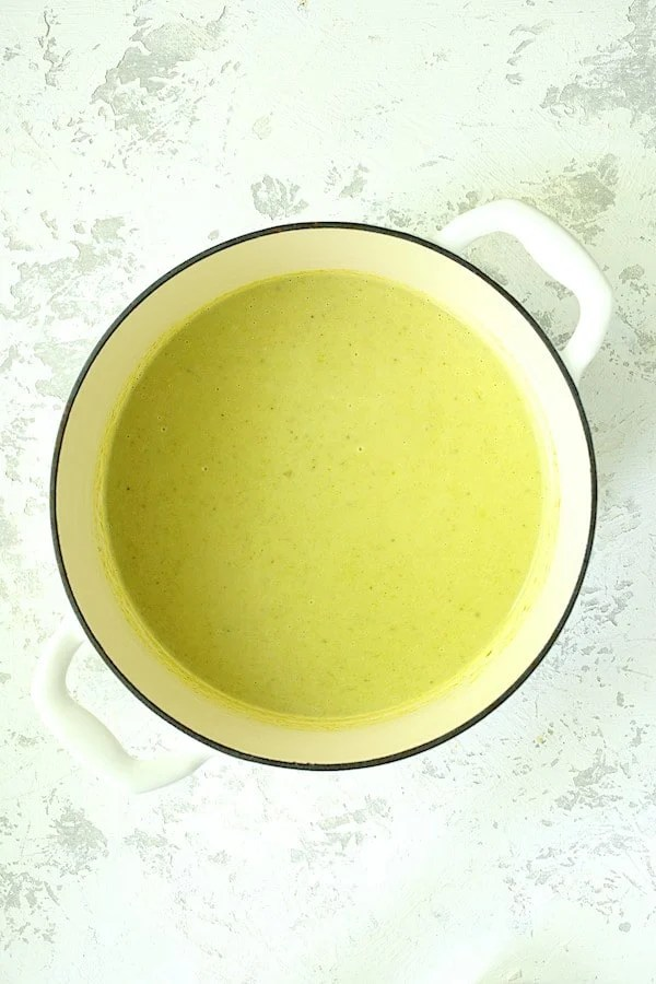 Cream of Celery Leaf and Scallion Soup - Overhead shot of soup in white Dutch oven