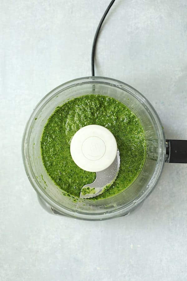 Overhead shot of basil salsa verde in food processor