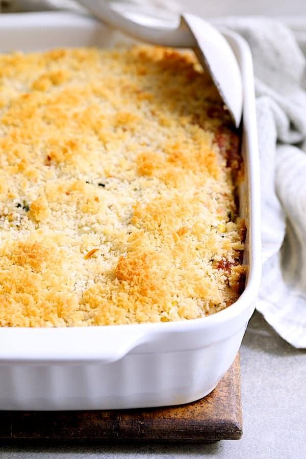 Zucchini, Yellow Squash and Quinoa Casserole - Close-up shot of baked casserole in white baking dish