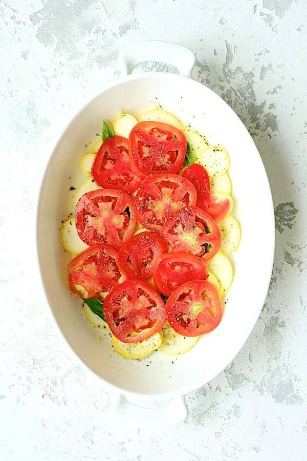 Yellow Squash and Tomato Gratin with Two Cheeses - Overhead shot of the tomato layer over the yellow squash