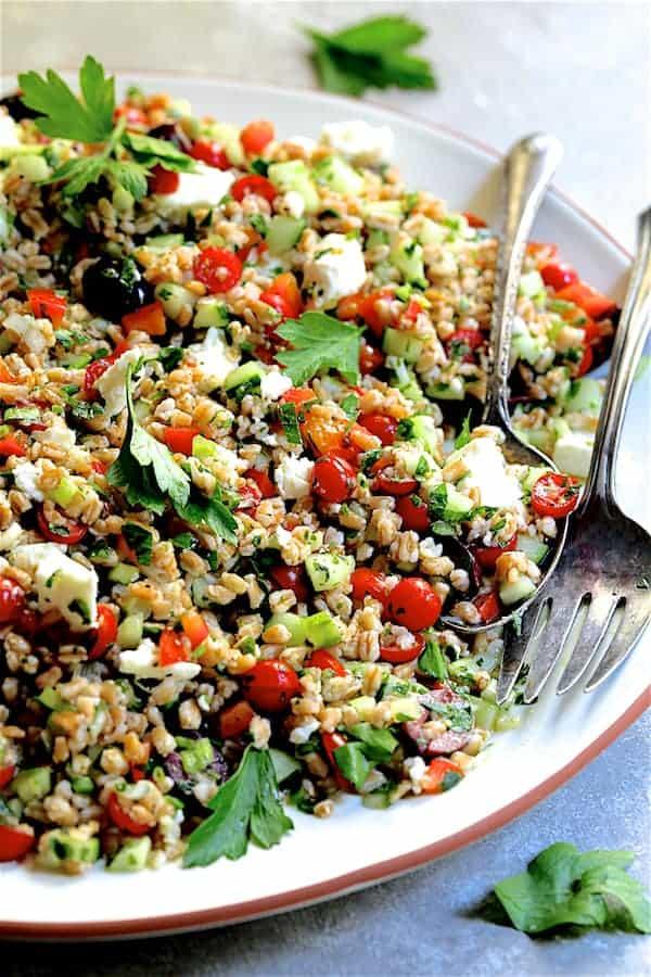 Greek Farro Salad - Close-up straight-on shot of salad on white platter