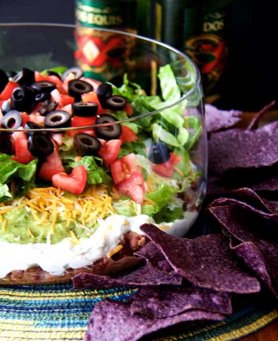 Healthier 7-Layer Dip has lots of fresher and lighter ingredients!  You're going to love serving it at your game day gathering--or any gathering. #7LayerDip #SevenLayerDip #appetizer #healthyappetizers
