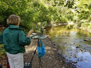 Picture of the artist painting near Sycamore Creek in Pickerington, Ohio