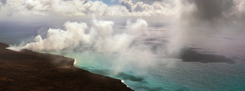 Smoke plumes from the lava entering the ocean at Kamokuna.