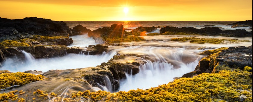 Golden sunset from the Big Island of Hawaii shoreline.