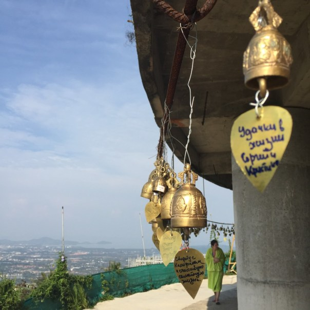 Bells with wishes written on them, hung around the Buddha