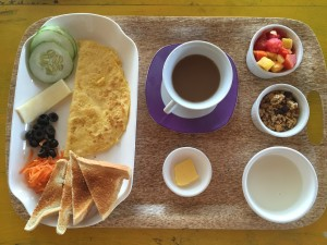 Breakfast of Champions! Plain yogurt, extraordinary granola and fresh fruit. Egg omelette, veggies, toast and coffee.