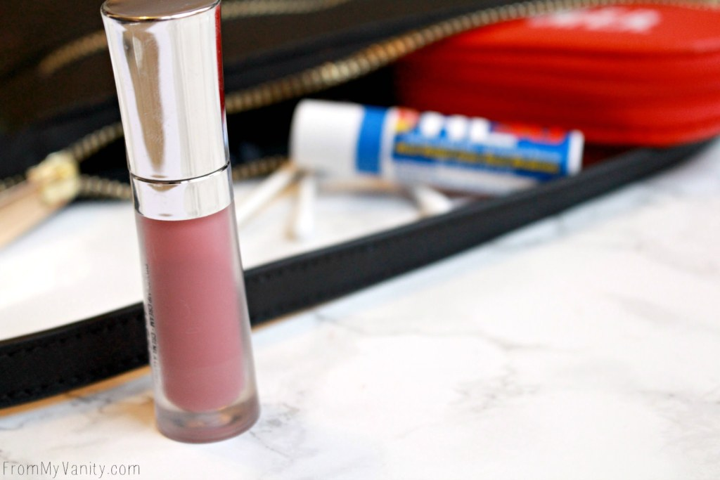 5 Purse Essentials Every (Practical) Makeup Junkie Needs | Buxom Lip Cream