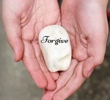 Forgive inscribed on a stone