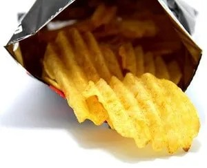 Snack potato chips heaps on a white background