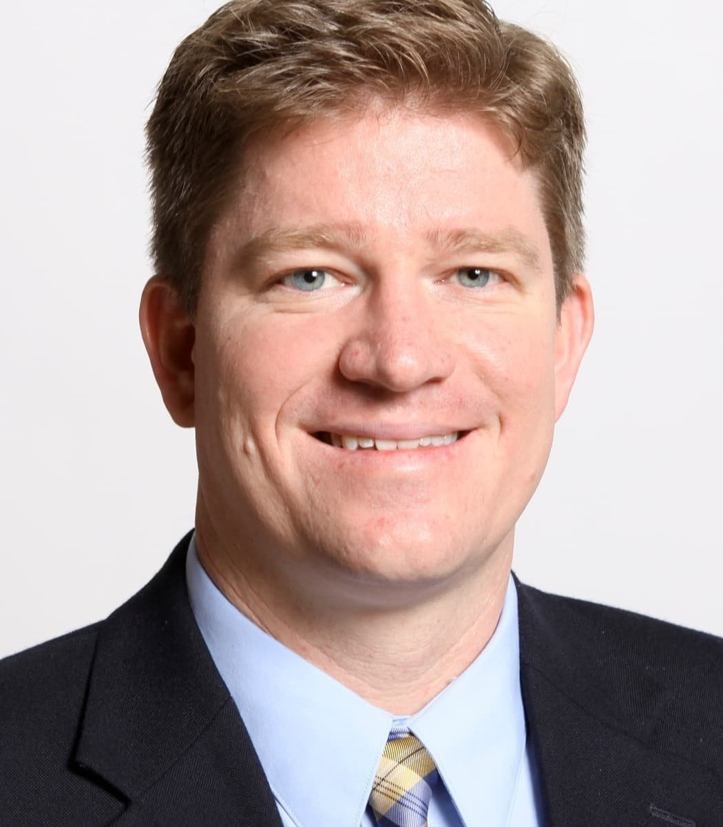 Keith Erekson wearing a suit and tie