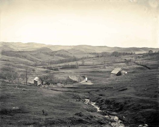 A 1907 black and white photograph by George Anderson showing buildings at Joseph and Lucy Smith's Tunbridge farm.