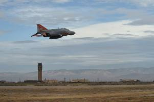 A QF-4 Phantom flies over Holloman Air Force Base, N.M., during the Phinal Phlight event on Dec. 21, 2016. This event marks the end of the aircraft's 53 years of service to the Air Force. (U.S. Air Force photo by Staff Sgt. Eboni Prince)