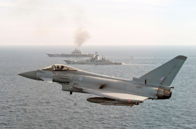 Image of a RAF Typhoon seen here in the foreground, with the Russian Warships Petr Velikiy (centre) and the Admiral Kuznetsov (background). Image credit: Crown Copyright