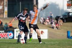 Luke Brattan challenging for the ball